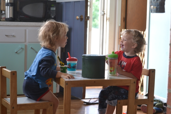 Breakfast time with two silly boys.  Constantly making each other laugh (and making a mess doing it).